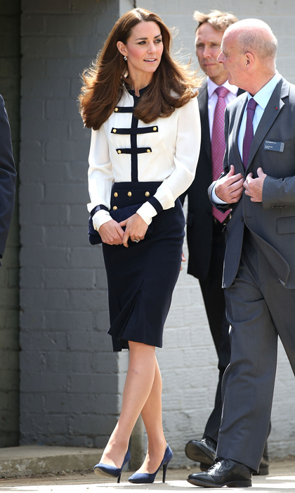 Military-inspired pieces take Kate's style to chic heights. Here, she pairs her Alexander McQueen silk blouse and pencil skirt with sensible, office-approved pumps. 