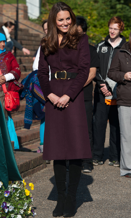 The Duchess of Cambridge means business in a knee-length aubergine coat and black suede boots.  
