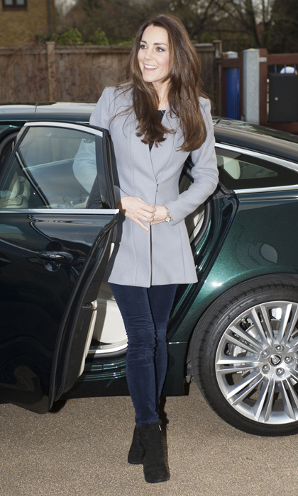 For personal engagements such as visiting childrens' charities, Kate tones down her ensemble in order to let the work of dedicated doctors, caregivers and teachers shine. Here she elevates casual pants with a fit-and-flare coat by Reiss. 