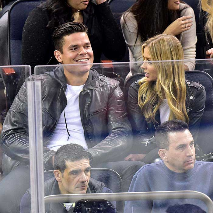 Tennis ace Milos Raonic and a blond date attended the face-off between the New Jersey Devils and the New York Rangers game at Madison Square Garden on April 4, 2015. (Photo: Getty Images)