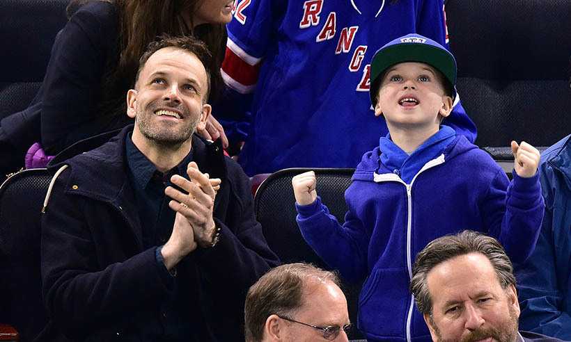 Jonny Lee Miller's son Buster Miller got in the spirit sporting his blues as the New York Rangers faced off against the Washington Capitals in March 2015 in New York. (Photo: Getty Images)