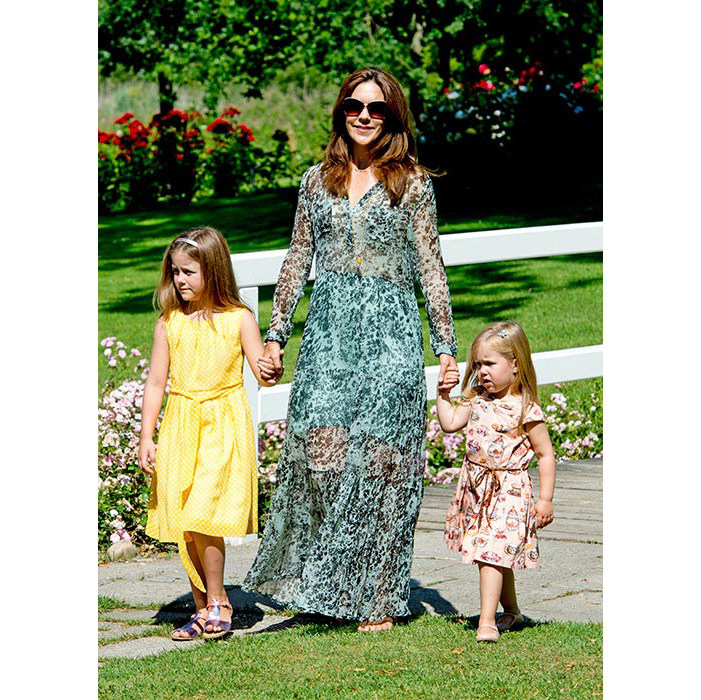 Princess Mary is the epitome of casual-chic in a patterned maxi dress for the Danish royals' annual summer photocall.  