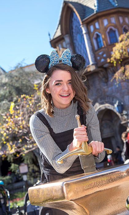 <em>Game of Thrones</em> leading lady Maisie Williams tried her hardest to pull the magical Excalibur sword out of the stone at Disneyland. 