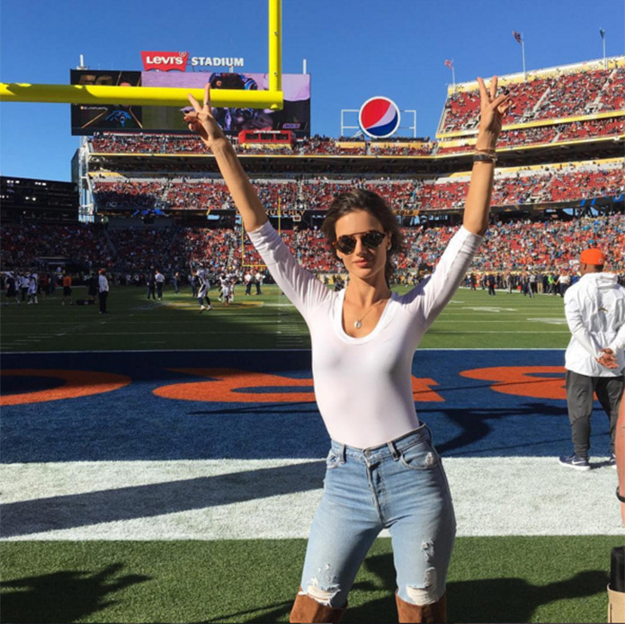 "Striking a pose in the stadium, Alessandra Ambrosio wrote: ""Super at the Super Bowl ✌️❤️ #SB50.""