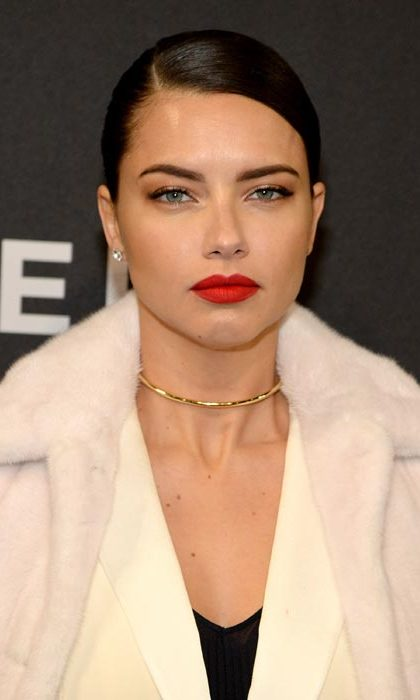 Adriana Lima attended the premiere showing off a stunning beauty look.