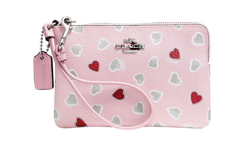<p><strong>Corner zip wristlet in heartprint coated canvas</strong>, $78,