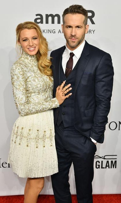The amFAR gala is one of the glitziest nights of the year, attended by a host of supermodels and celebrities. But it was all eyes on handsome couple Ryan Reynolds and Blake Lively as they stepped out onto the red carpet on Wednesday evening. Blake looked dazzling in a gold Chanel dress, while Ryan was dapper as ever in a charcoal suit.