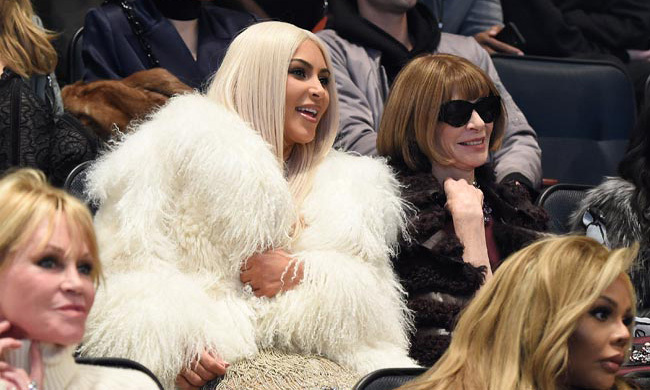 Kim was seated next to Anna Wintour and the pair chatted away before the show began.