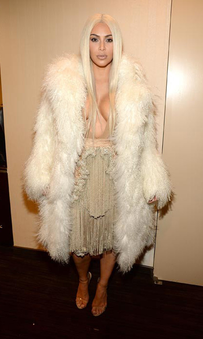 <p>Kim Kardashian pulled out all the fashion stops as she attended husband Kanye's New York Fashion Week show at Madison Square Garden. The fur and fringe-clad reality star swapped her famous dark locks for a blond wig, seemingly inspired by her hair chameleon sister Kylie Jenner.</p>