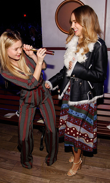 Suki Waterhouse (R) had some fun with sister Immy at Tommy Hilfiger. 