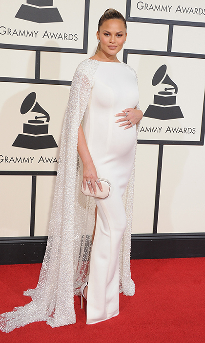 The stunning star looked like a mom-to-be superhero in a jewel-encrusted caped Yousef Al-Jasmi gown at the 2016 GRAMMY Awards. 