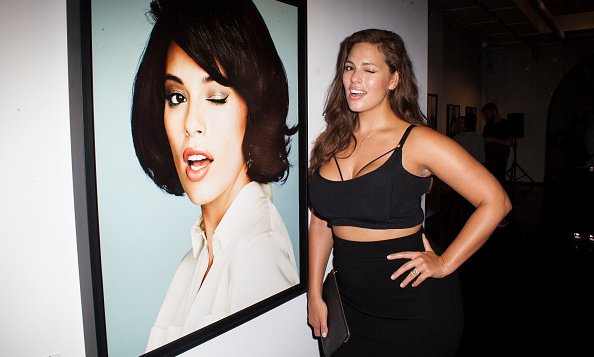 "She also has her own website, www.ashleygraham.com, with the slogan, ""Stand up for curves, confidence is sexy.""
