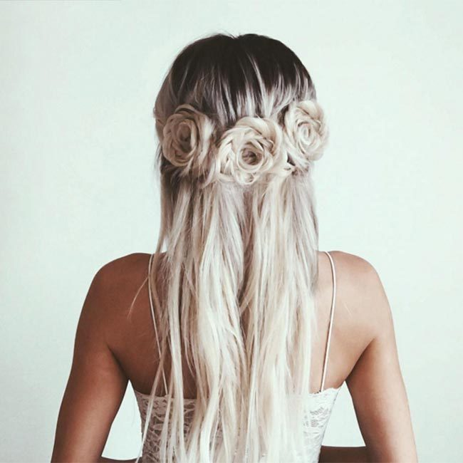 "We're seriously coveting this beautiful floral-inspired plaited look created by <a href=""https://www.instagram.com/emilyrosehannon/"" target=""_blank"">@emilyrosehannon</a>!