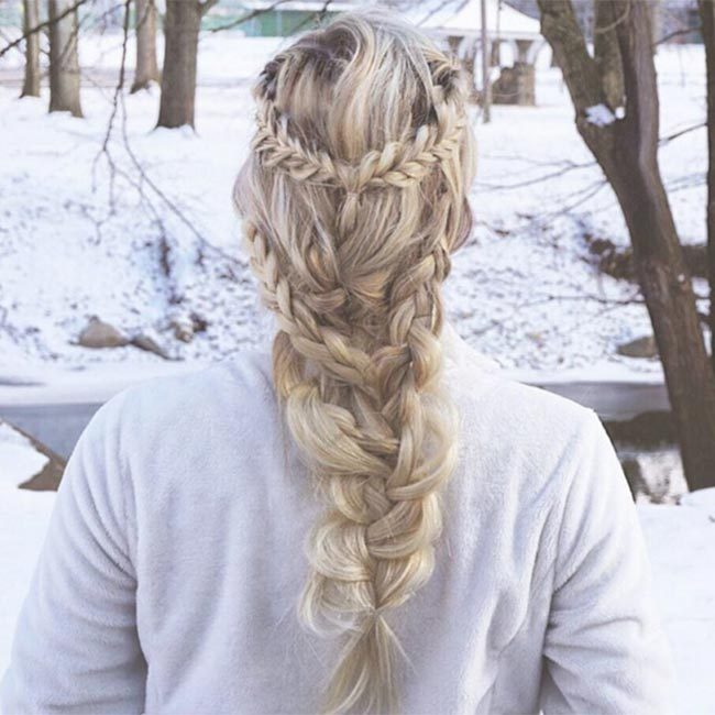 "We love the way <a href=""https://www.instagram.com/laineymariebeauty/"" target=""_blank"">@laineymariebeauty</a> has mixed and matched different plaits for a boho-inspired chic look.