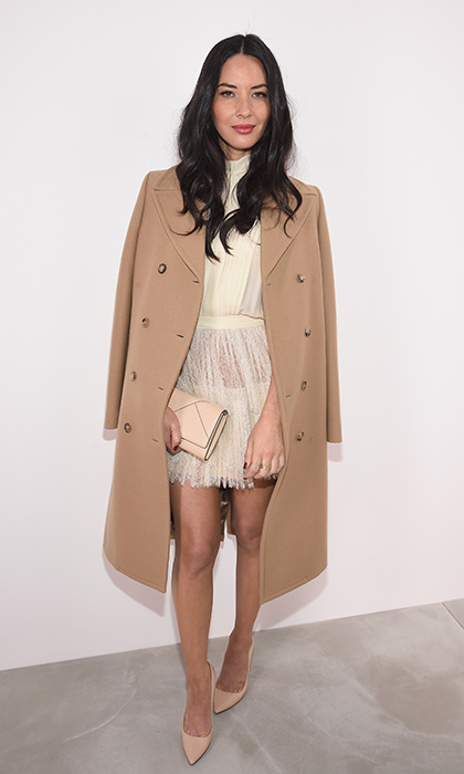 Olivia Munn didn't let the cold snap that hit New York cramp her style: she added a camel coal over her cream silk Michael Kors dress and nude pumps for the designer's Fall 2016 runway show at Spring Studios. 