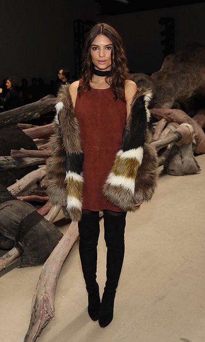 Actress Emily Ratajkowski slung a plush, colour-block Dawn Levy coat over her suede dress and black thigh-high boots for Public School's Fall 2016 runway show at New York Fashion Week. 