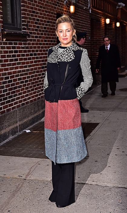 Kate Hudson maintains her signature boho sensibilities with a mix of textures and patterns in this cozy Roland Mouret coat for an appearance on the <em>Late Show with Stephen Colbert.</em>