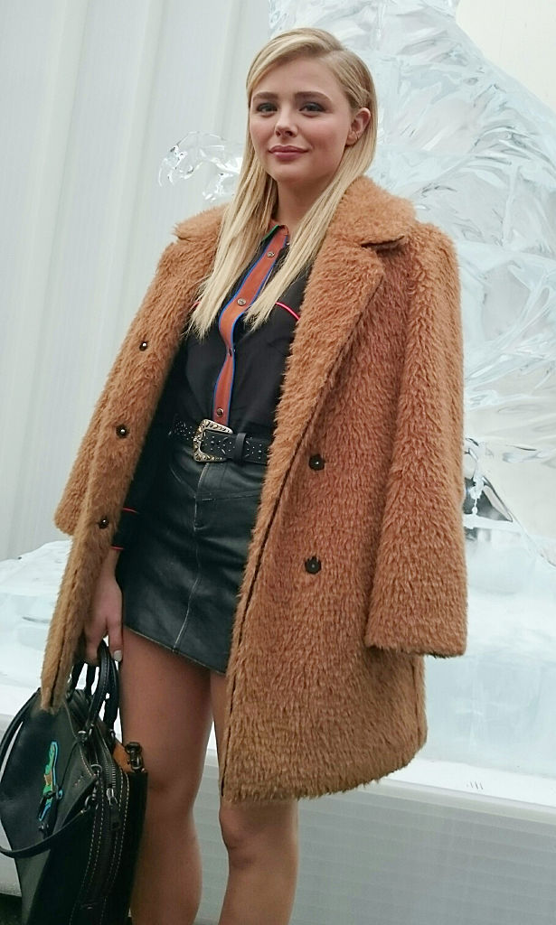 Chloe Grace Moretz braved the NYC cold with a furry brown coat at the Coach fashion show.