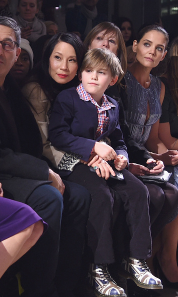 Lucy Liu took in the Zac Posen show with a little friend.