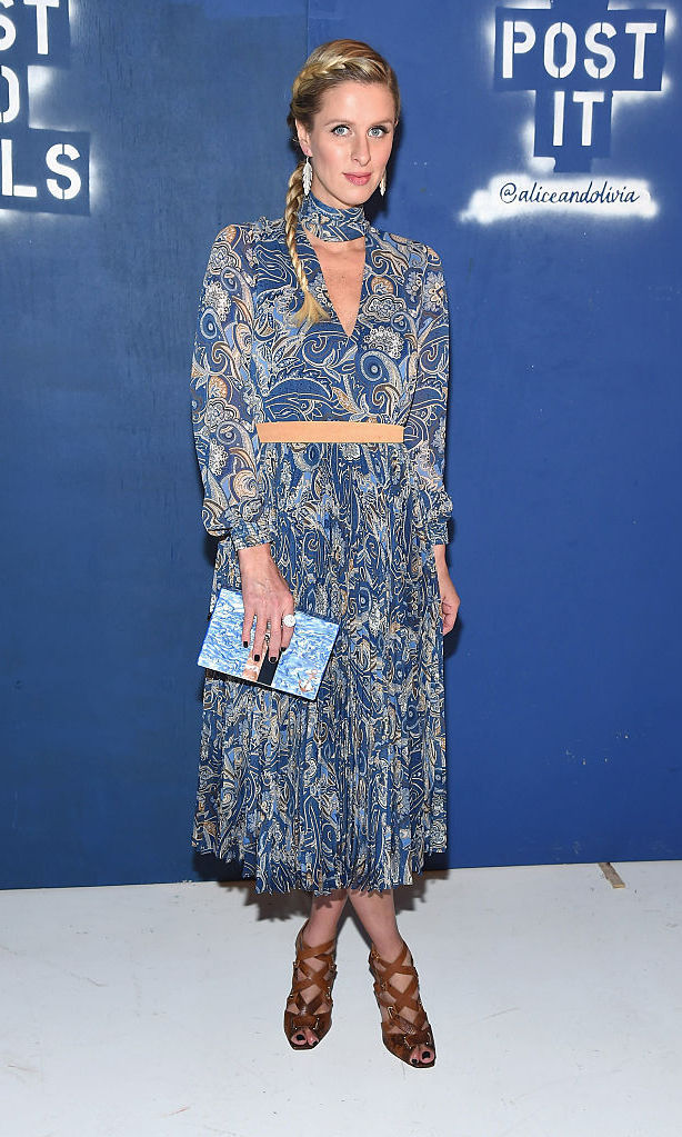 A pregnant Nicky Hilton hit up the Alice + Olivia by Stacey Bendet presentation wearing a flowy, bohemian blue dress.