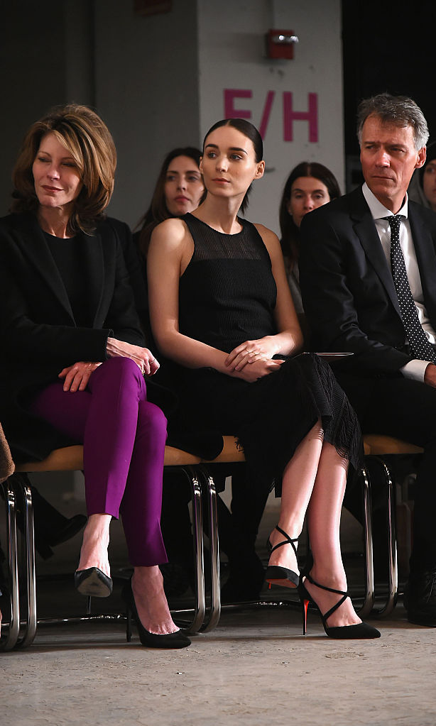 Oscar nominee Rooney Mara (right) sat front row at the Boss Womenswear fashion show next to ELLE magazine's Editor-in-Chief Robbie Myers.