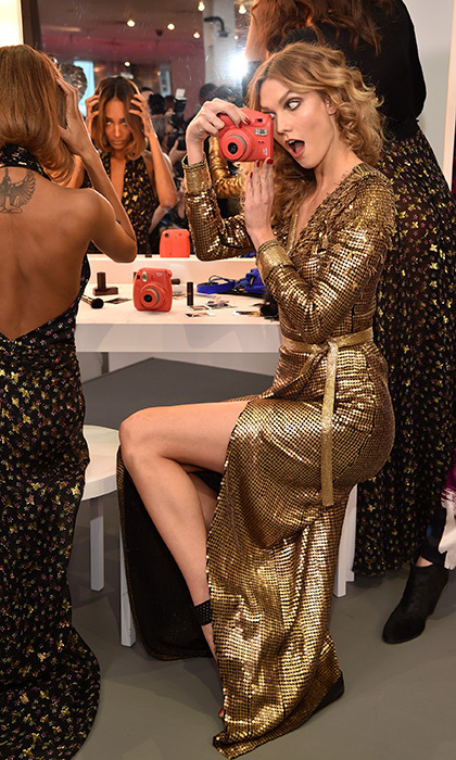 Karlie Kloss snapped a glamorous photo during the Diane von Furstenberg Fall 2016 presentation, where the world's most famous models were dancing to disco and primping at vanities. 