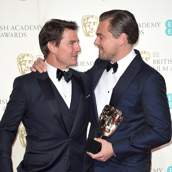Making a case for navy tuxedos, Tom Cruise and Leonardo DiCaprio - who scored top as the night's Best Actor - palled around in the winner's room at the BAFTAS.