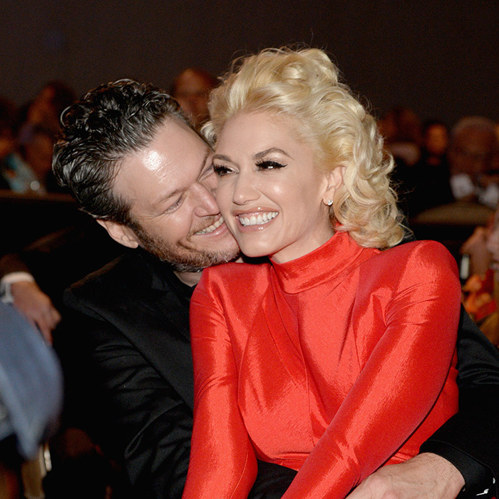 "Blake Shelton and Gwen Stefani made a loved-up appearance at Clive Davis's annual pre-GRAMMY party, where the ""Make Me Like You"" singer perched on her new beau's lap. 