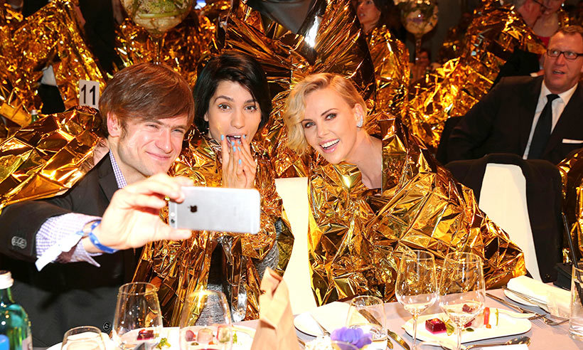 Pussy Riot's Nadya and her husband posed with Charlize Theron in artist Ai Wei Wei's golden refugee jackets, which spawned a barrage of selfies at the Cinema for Peace Gala in Berlin.
