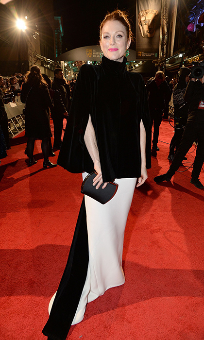Julianne Moore draped a sleek black cape over her white gown (both Armani) for the 2016 BAFTAs in London. 