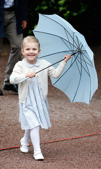 July 2015: Estelle was camera (and rain) ready during Crown Princess Victoria's 38th birthday celebration.