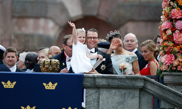 June 2015: Big wave! Estelle greeted the crowd while departing the royal palace with her mother and father following her uncle Prince Carl Philip's wedding to Princess Sofia. 
