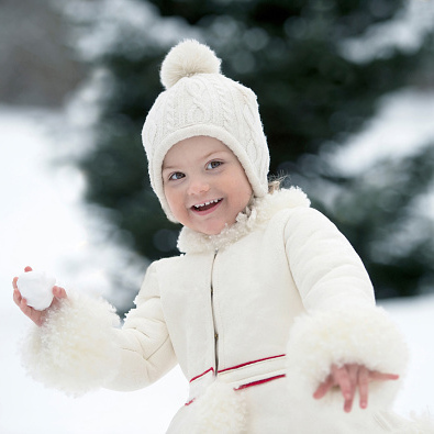 February 2015: Snow angel Estelle enjoyed a little snowball fight as she turned three.