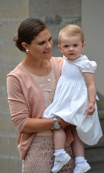July 2013: Princess Estelle posed for a quick picture with her mom during the Victoria Day celebrations at Solliden Palace.