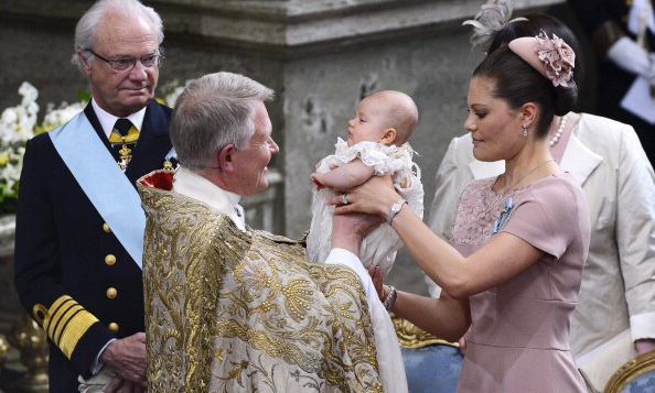 May 2012: Crown Princess Victoria gently handed little Estelle to Archbishop of Uppsala Anders Wejryd during her christening ceremony at the royal chapel in Stockholm.