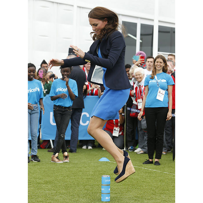 She may have been wearing a tight dress and wedges but that didn't stop the Duchess of Cambridge from joining in the South African game 'Three Tins' during a visit to the Commonwealth Games in 2014.