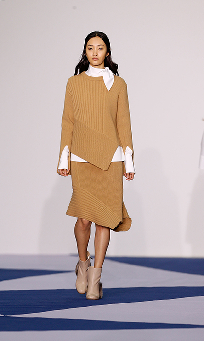 The former TV personality has rocked knitwear in the past, so Eudon Choi's inventive take on a sweater and skit combo is just what she needs to elevate one of her go-to fashion looks.