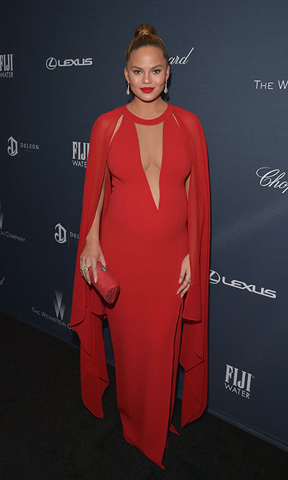 In caped red Michael Kors at  The Weinstein Company's pre-Oscar dinner. 