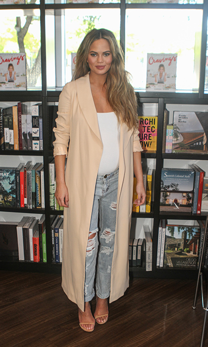 Looking relaxed and comfortable, the mom-to-be paired her casual jeans and tank top combo with a beautiful beige over coat at the launch of her new cookbook <i>Cravings</i>. 