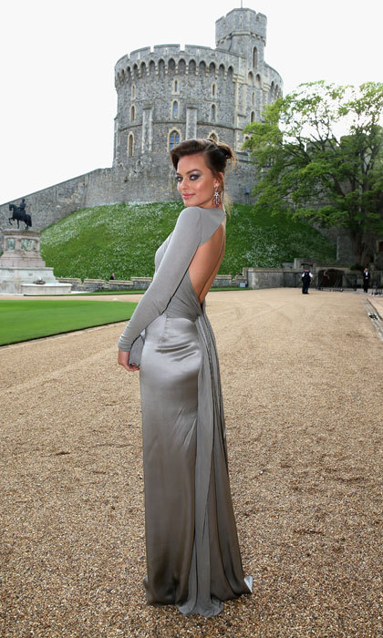 Attending a dinner at Windsor Castle in a slinky satin grey gown.