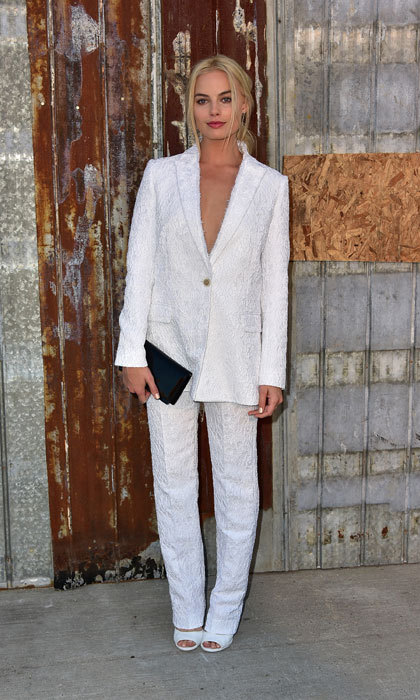 Channelling androgynous chic in a white suit to attends the Givenchy show during Spring 2016 New York Fashion Week.