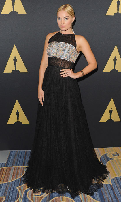 Rocking a gothic black gown at an Oscars luncheon.