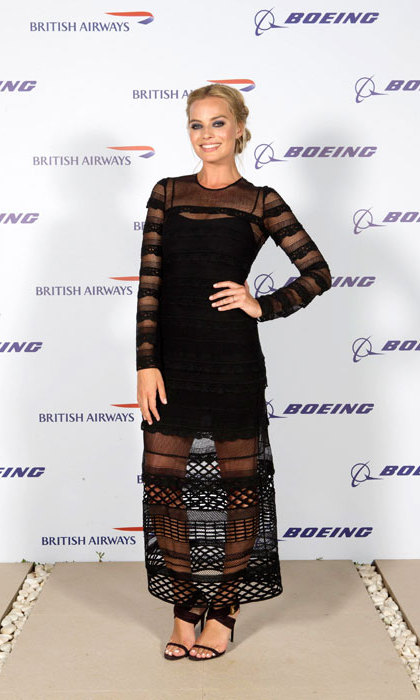 Attending a British Airways party in a black Self-Portrait dress. Check out the hair - how stunning!