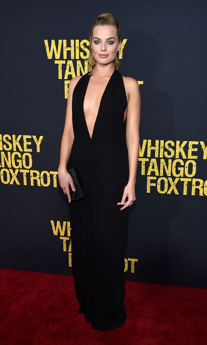 Just two days later, the <em>Wolf of Wall Street</em> star stepped out looking just as incredible, hitting the premiere of <em>Whiskey Tango Foxtrot</em> in a black plunging Valentino jumpsuit that showed off her seriously enviable curves.