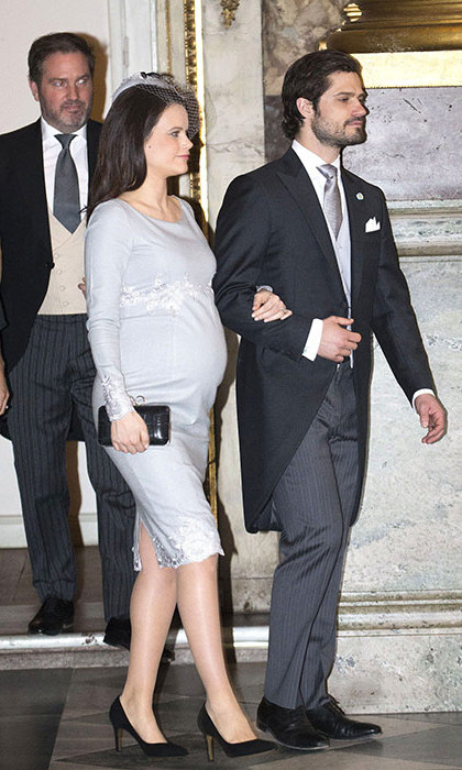 Not long now! Here, a very pregnant Sofia and her husband arrive at a special service of thanksgiving to celebrate the Mar. 2 birth of Prince Oscar of Sweden. 