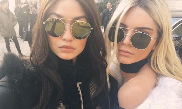 Hair flip! Kendall Jenner and Gigi Hadid traded looks before the Balmain fashion show.