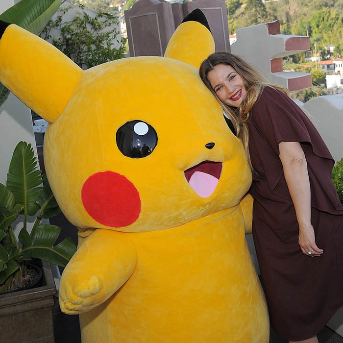 Drew Barrymore and new friend Pokemon shared a hug at at a party hosted by Tracy Paul & Co. in West Hollywood.