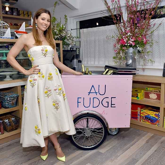 Mom-of-one Jessica Biel strikes a happy pose at the grand opening of her kid-friendly eatery Au Fudge in Los Angeles. 