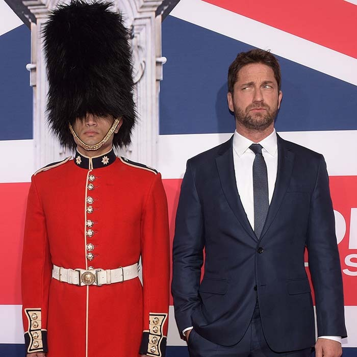<i>London Has Fallen</i> star Gerard Butler gave his best Queen's guard impression while promoting his new action film in Los Angeles. 