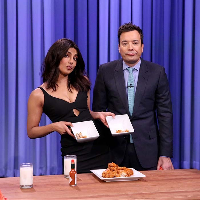 <i>Quantico</i>'s leading lady Priyanka Chopra showed Jimmy Fallon how it's done by beating the late show host in a hot chicken wing eating competition. 